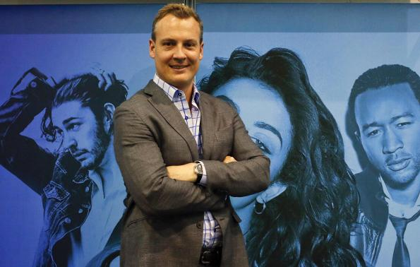 Shazam's Chief Executive Rich Riley poses after an interview at the Mobile World Congress in Barcelona